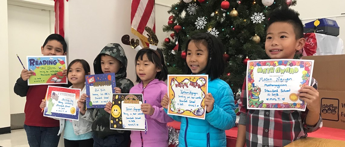 Our hard-working Kindergarteners proudly display their awards at the Awards Assembly!