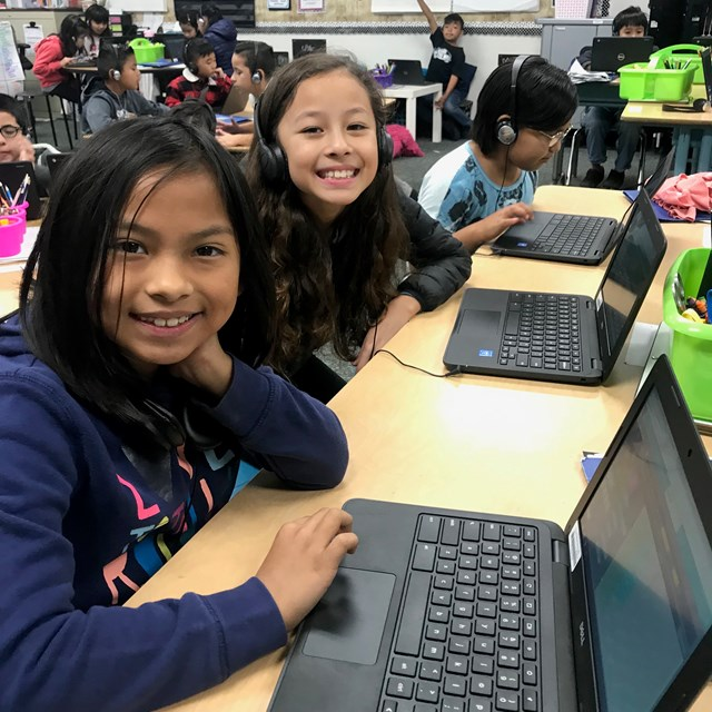 Students working on Chromebooks during technology time.